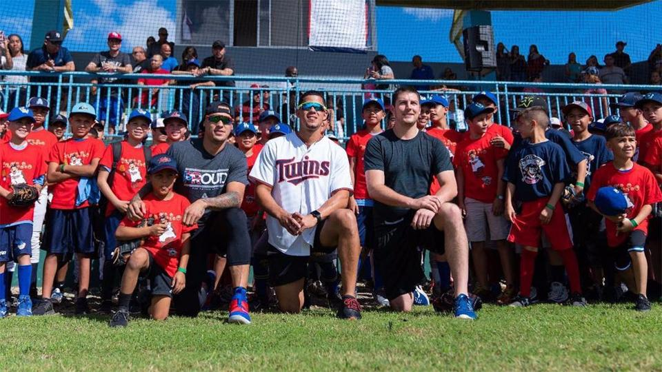BAYAMON, Puerto Rico -- On the eve of Three Kings Day, a major holiday in Latin America marked by festivals and children eagerly awaiting presents, Twins ace Jose Berrios gave kids in his native Puerto Rico the gift of baseball. With assists from Cubs infielder Javier Baez and Indians starter Trevor Bauer, the gift took the form of a youth clinic in Berrios' and Baez's hometown of Bayamon on Saturday.