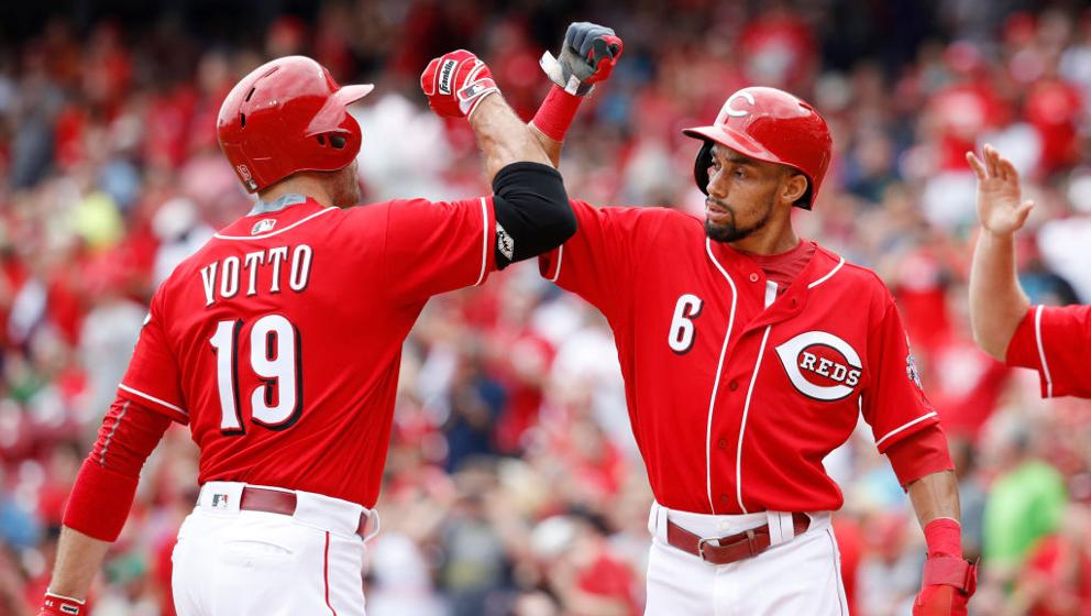 Joey Votto, Billy Hamilton and Eugenio Suarez gave gear to fans after being pulled from the Reds game