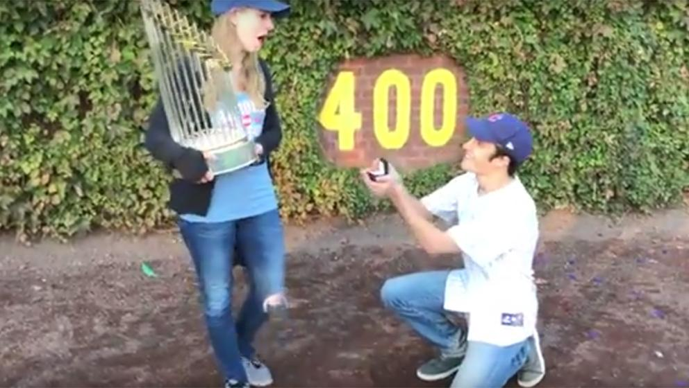 ed9ce288e1e Cubs fan proposes at Wrigley Field with World Series trophy
